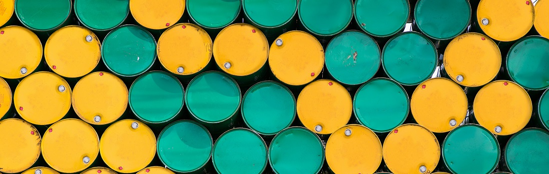 stacked yellow and green oil barrels