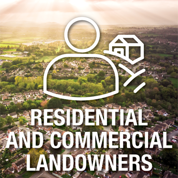 Landowners icon over top of an image depicting aerial view of residential and rural
